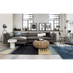 Shop code rug.   Muted flatweave bands together tonal greys, tan and soft blue, accented by clean white triangle and trio of black lines.