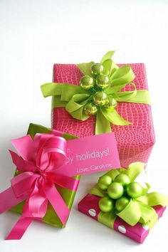 Christmas holiday gift wrap idea: hot pink croc embossed print wrapping paper, green ribbon, green bauble decorations