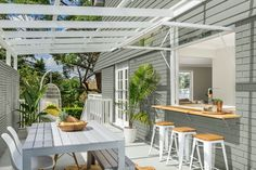 Three Birds Renovations transform an outdoor space. This inviting area features a cut to measure timber ledge available at Bunnings. Outdoor Areas, Outdoor Rooms, Outdoor Living, Outdoor Decor, Indoor Outdoor, Alfresco Designs, Alfresco Ideas, Side Yard Landscaping, Landscaping Ideas