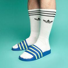 If you're going to do socks and sandals, do it right in matching Adidas.