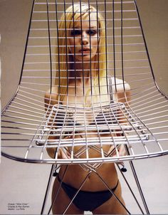 If this Eames wire chair was used the way Charles and Ray intended it, as an Upholstered Wire Chair, then you wouldn't see the girl in the bikini.  But then, you wouldn't see the girl in the bikini.  From a short lived French magazine, ARCHI-DESIGN, that celebrated design and fashion