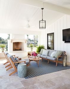 Ranch-style Beach House-he back porch features plenty of seating space, an outdoor fireplace and a soothing color palette. - Garden and Home Outdoor Fire, Outdoor Areas, Outdoor Rooms, Outdoor Decor, Indoor Outdoor Living, Living Room Designs, Living Spaces, Home Theaters, House With Porch