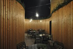 The garden patio of the Peppino Restaurant, designed by Atelier 111 Architekti, has the plants planted between its outer and inner shell. Gable Wall, Coffee Restaurants, Best Architects, Wooden Slats, Best Wordpress Themes, Interior Design, Design Interiors, Stairs, Patio
