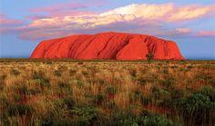 Australia's hot sun sets Ayer's Rock aglow.
