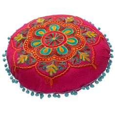 Embroidered Gypsy Caravan Cushion. // The embroidery and colors are so pretty, I would like little bells around the edges.