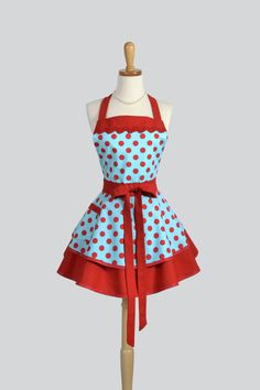Our Ruffled Retro full woman's apron is a fun and flirty kitchen cooking apron in a vintage style full skirt. This retro rockabilly turquoise and red polka dot is a throwback to the pinup style of the