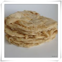 Roti is a Guyanese flat bread with Indian influences. It is a simple paratha with flour, shortening of some form, baking powder and oil. It is a staple in most Guyanese households and go well with . Roti Recipe Guyanese, Guyanese Recipes, Vanilla Fudge, Vanilla Custard, Steamed Dumplings, Indian Food Recipes, Ethnic Recipes, Indian Foods, Indian Dishes