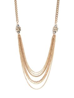 Live the luxe life in this dramatic statement necklace that's equal parts elegance and sophistication. It features a lush cascade of gold chain links and two dazzling crystal cluster accents.
