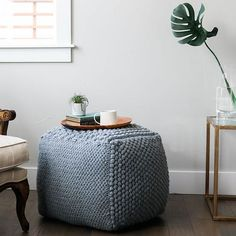 This crochet pouf pattern lets you'll build new skills while making your own functional furniture. Worked in six squares with six different stitches, this large show-stopper is a surprisingly portable project. This pouf makes a great seat or ottoman, or set a tray on it to make a texture-rich side table. Perfect crochet project for nurseries, living rooms or bedrooms.