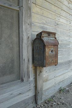 Old Rusty U.S. Mail Box...aging patina...weathered wood.