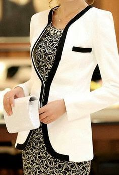 Very elegant combination of patern dress and white jacket in everlasting black and white combination. Stunning Mum of the Bride and dress.:)