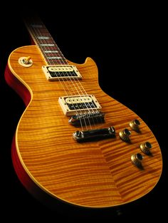 """Interesting design on the Maple top. I'm always biased toward the """"Natural"""" though. My first LP Deluxe """"Teddy"""", is a Natural and has been with me now for 35 years.... Cheers!"""