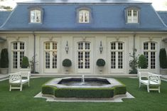 Garden courtyard for French styled house by Howard Design Studio.