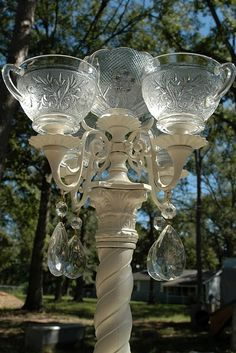 vintage punch cups glued onto a painted brass/wood candelabra with crystal drops added