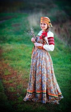 Russian traditional costume of an unmarried peasant girl: an embroidered blouse, a sarafan (a kind of a sleeveless dress) and a nice headband (only married women wore kokoshniks).