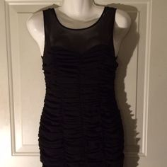 Ruffled Bodycon Dress Ruffled black Bodycon dress from forever 21. Size medium. Zips up in the back. Perfect for just a night out or a formal event. Versatile enough to be your go to little black dress! XXI Dresses Mini