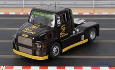 Flyslot Sisu racing truck in United Postal Service fantasy livery. This is a very High Detail Slot Car. Real Racing, Slot Cars, Trucks, Vehicles, Dreams, Shop, Racing, Slot Car Tracks, Truck