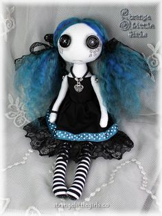 A custom 8 inch Gothic cloth art doll with button eyes and teal hair…