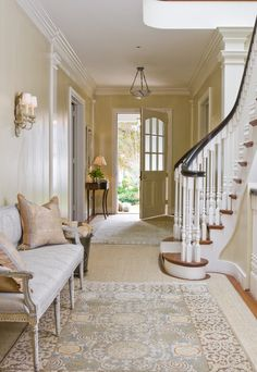 Beautiful staircase and hallway; lovely muted tones. Back entryway.