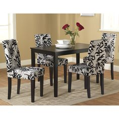 Update your dining room with this black and white five-piece dining set. With its solid wood frame and sophisticated, printed plush upholstery, this dining set will give your home a comfortable and stylish place to share a meal with friends and family.