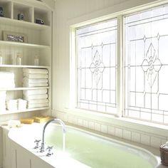 Decorative Glass Fixed Windows in White Bathroom Remodel