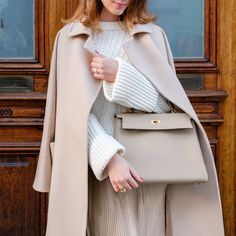 Wearing Hermès Kelly Bag in color Trench (size 32) and Max Mara Lampo coat