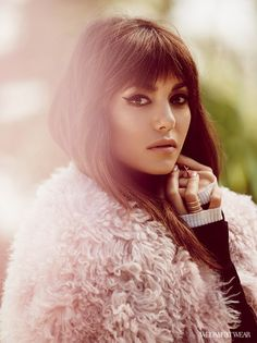Nina Dobrev wears a fur coat, turtleneck sweater, and delicate rings, photographed by Zoey Grossman