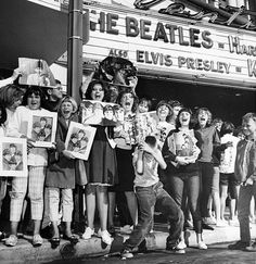 Beatles' groupies in front of a Movie theater looks like Elvis Presley's Movie is also playing!