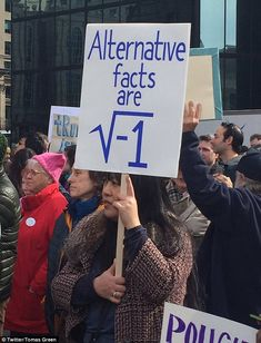 More than 1,000 people gathered in Copley Square with signs geeky enough to leave other scientists perplexed. This sign declared 'alternative facts' were the 'square root of -1' and started a debate on Twitter to find its true meaning
