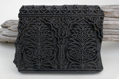 Hand carved wood block from India.