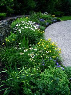This GardenWeb forum post has LOADS of garden inspiration!