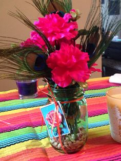 Mason jar with a Loteria tag and fuchsia flower arrangement #masonjar #mexicanparty #loteria
