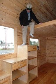 Tiny houses are so cute! Bookshelves do double duty as stairs to a loft.