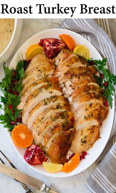 Oven Roast Turkey Breast - it's smothered in rich butter, savory herbs and vibrant garlic then roasted to golden brown perfection. Easy prep and delicious results! Perfect for your Thanksgiving meal. #turkey #turkeybreast #thanksgiving #recipe