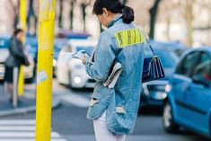 Woman wearing an Off-White denim shirt, white jeans and Nike shoes after the Marni Fall/Winter 2015-2016 fashion show in Milan, Italy