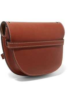 Light-brown leather (Calf) Tab-fastening front flap Comes with dust bag Weighs approximately 1.1lbs/ 0.5kg Made in Spain
