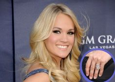 Carrie Underwood's engagement ring from hockey player Mike fisher features a yellow diamond.
