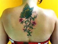 Butterfly And Vine Lily Floral Tattoo On Girls Upper Back To Nape
