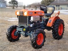 KUBOTA Tractor ..almost looks like a jacked-up racing tractor!!B7000 or B7100 from 1970s