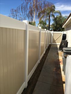 Vinyl fence Tan and white color. No maintenance. Installed by 3T Fence (951) 304-9828
