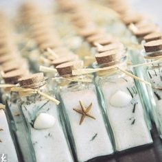 "Cute idea for favors. Could be filled with sea  salt and could say something like ""so you can take the sea back home with you"" or something. Cute and budget friendly!"