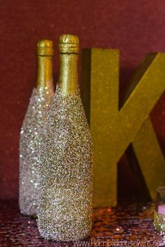 Decorate a bottle of blush cocktail with pink and gold glitter for a pink and gold bridal shower. #ambassador #sponsored