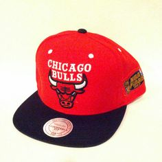 Manufactured by Mitchell & Ness, this Hardwood Classics Flat Bill Chicago Bulls limited item features a black cloth flat bill with a red cap. This is a 1997 NBA Finals Edition Hat. The back features an adjustable snap strap. On the front you will find the Chicago Bulls team logo embroidered in thick premium thread with the signature Mitchell & Ness logo embroidered in gold in the back. The side features the 97' NBA Finals logo embroidered in premium thread. IN STORE ONLY!