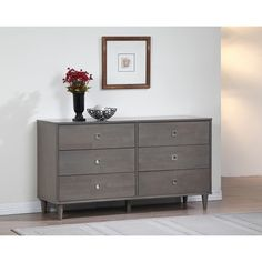 Sleek lines and a neutral gray color make this six-drawer dresser a good fit for your bedroom. Store clothing or linens in the spacious drawers, which sit on metal glides that make them easy to open.
