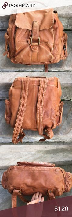"""Vintage large brown leather backpack 1970's Vintage 1970's brown leather large/XL backpack/rucksack. Made in Colombia. Drawstring closure. Unlined, raw leather interior. Large drawstring close main compartment, large zip closure front pocket with pen organizer, two side pockets, and one zip close pocket on front flap. Heavy duty and thick durable leather. CONDITION: distressed, but great all over patina!! All zippers work well and no holes or rips. Approx. 15x15 x6-7"""" big enough for a…"""