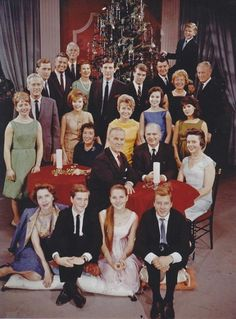 The entire cast of AS THE WORLD TURNS posed around the Christmas tree for ...