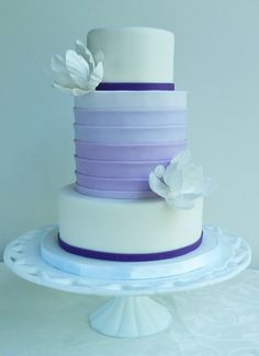 An ombre middle tier with dark and white accents.  Genius!  By The Cake Whisperer