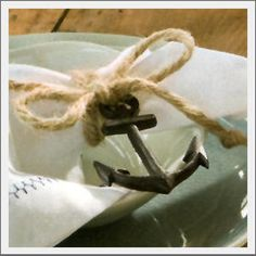 Nautical napkin ring. Obsessed with rope and anchors this summer!