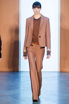 For the suits, he worked boy blazers with shorter sleeves—the better to style over extra long-sleeved knits, sleeveless layered vests and the like over long, loose trousers.   - HarpersBAZAAR.com