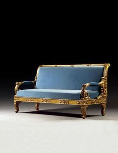 A GERMAN CARVED GILTWOOD AND GESSO SOFA, IN THE MANNER OF SC